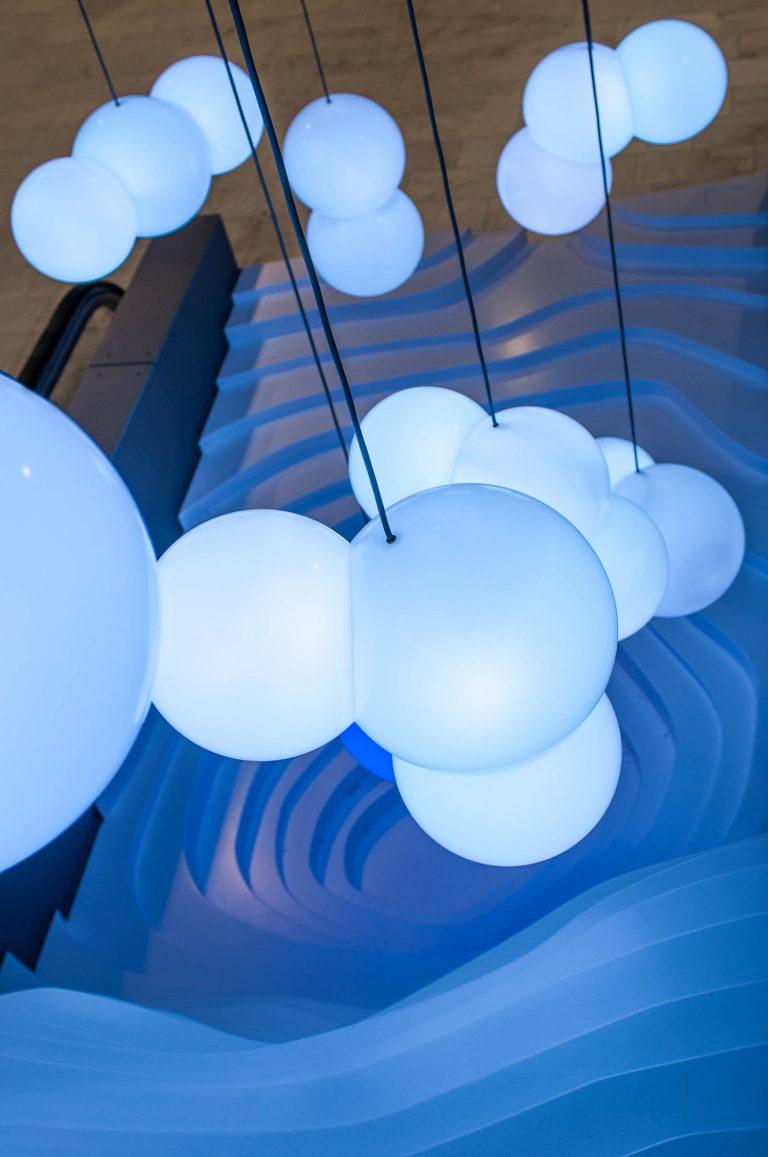 En kluster av hängande ljusblå lampor. Bigert & Bergström, Morgondagens Väder, 2012.