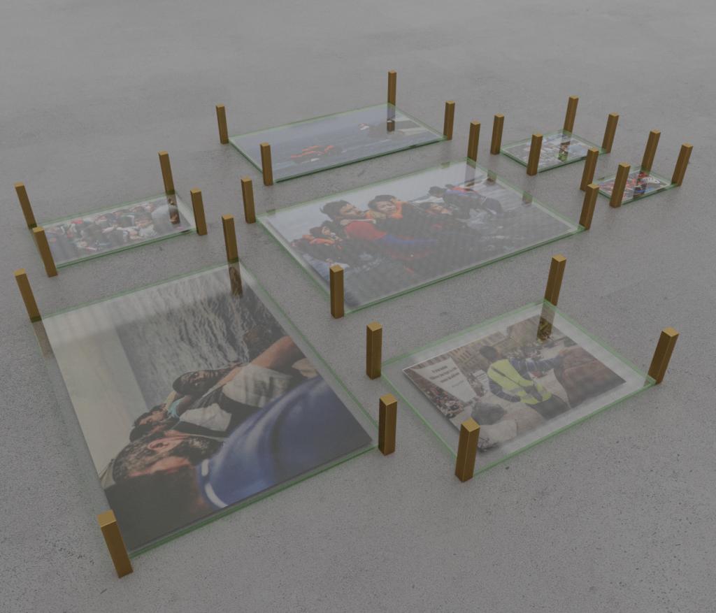 Inglasade bilder ligger på ett golv. Fyrkantiga bronsstavar markerar kanterna på bilderna.